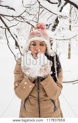 Woman Blowing Snow Flakes