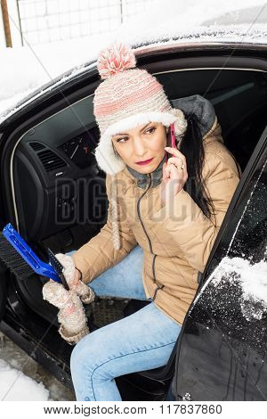 Woman Having Problem With Car In Snow