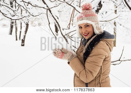 Happy Woman Holding Snow In Her Hands