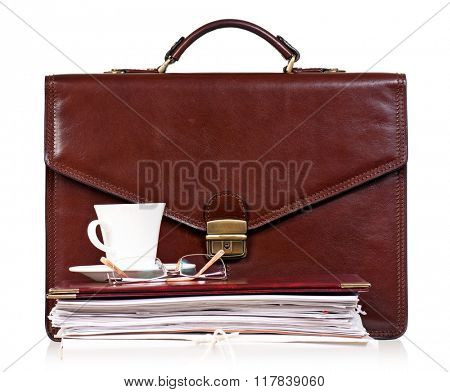 Brown leather briefcase with office accessories, isolated on white background