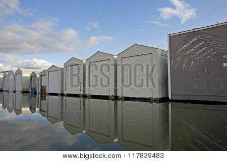 Boat Houses And Reflections