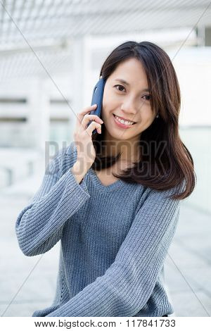 Young woman talk to phone
