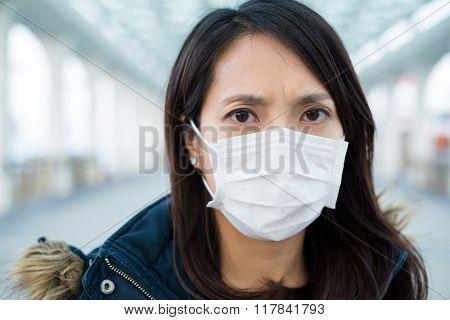 Woman wearing medical mask at outdoor