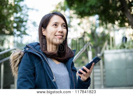 Woman hold with mobile phone