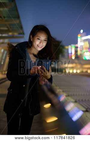 Woman use mobile phone at outdoor