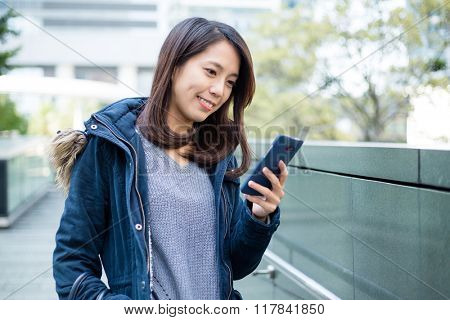 Young woman look at cellphone