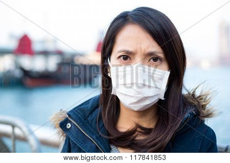 Woman wearing medical mask at Hong Kong