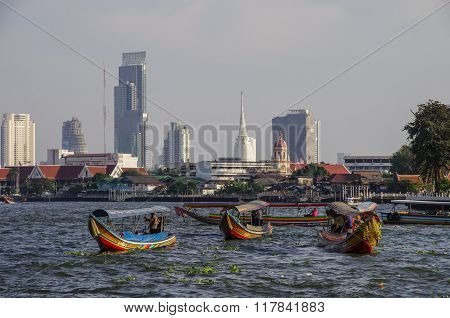 Bangkok,thailand -  25 July 2010: Long Boats On Chao Phraya River With City Panorama In Background.