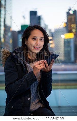 Woman use phone at night