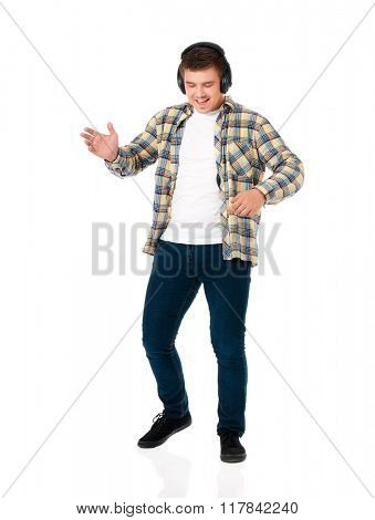 Young modern man with headphones isolated on white background