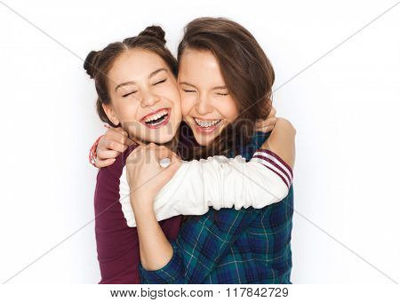 people, friends, teens and friendship concept - happy smiling pretty teenage girls hugging and laughing