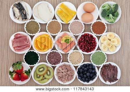 Health and body building high protein super food of meat, fish, dairy, supplement  powders, fruit and vegetable selection.
