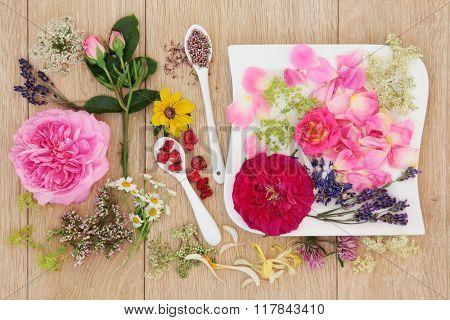 Natural herbal medicine flower and herb selection over oak background.
