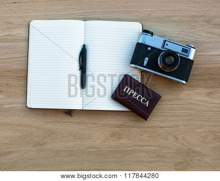 Notebook with pen, camera and Russian Press ID.