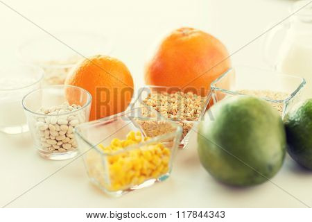 healthy eating, breakfast, diet and culinary concept - close up of food ingredients on table