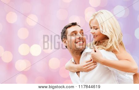 romance, people, love and dating concept - happy couple over holidays lights background