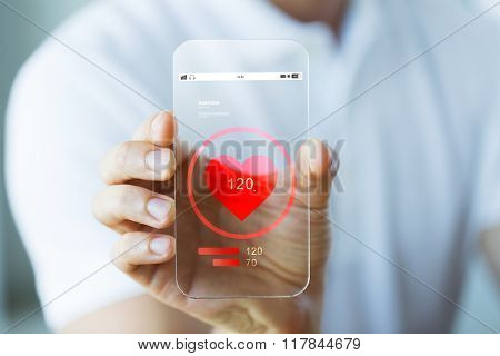 business, technology, health care and people concept - close up of male hand holding and showing transparent smartphone with heart rate icon