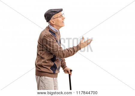 Studio shot of a senior gentleman arguing with someone isolated on white background
