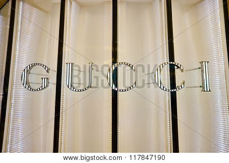 HONG KONG - JANUARY 27, 2016: Gucci logo on the wall at Elements Shopping Mall. Gucci is a luxury Italian fashion and leather goods brand, part of the Gucci Group