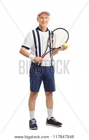Full length portrait of a senior man holding a racket and a tennis ball isolated on white background