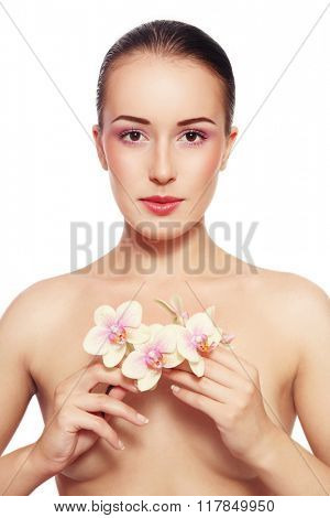 Young beautiful slim healthy woman with fresh make-up and white orchid over white background