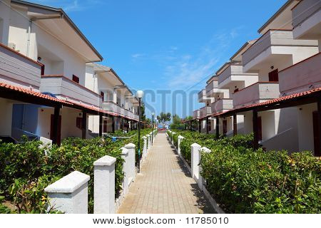 View Of Resort On Coast. Three-storey Villas With Balconies