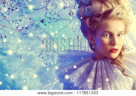 Close-up portrait of a fairy Ice Queen standing in a magic winter forest. Beauty, fashion.
