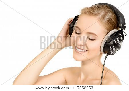 Smiling girl in headphones. Isolated over white background. Copy space.