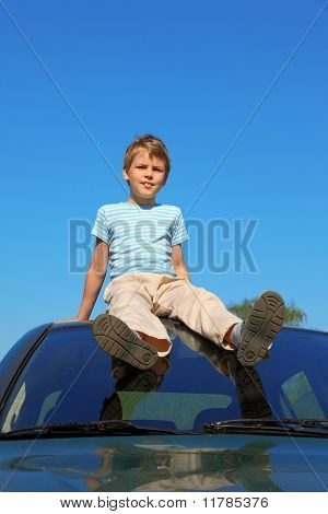 Boy Sitting On Roof Of Car, Blue Sky