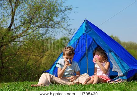 Children Drinking Water In Tent