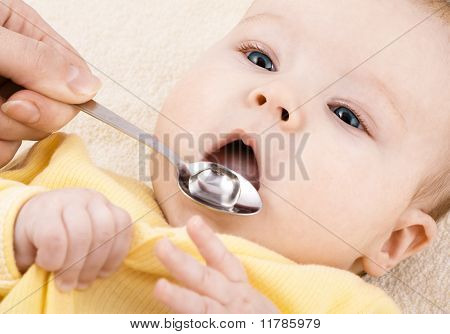 Child is drinking medicine syrup or water
