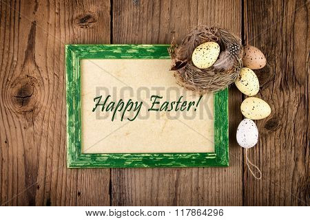 Easter decoration with green wooden frame. Top view Text Happy Easter
