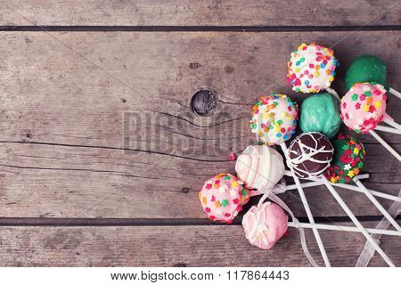 Cake Pops On  Vintage Wooden Background.