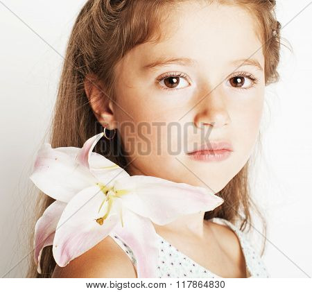 little cute spring girl with lily flower in fancy dress isolated on white background