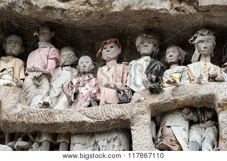 Wooden Statues Of Tau Tau. Suaya Is Cliffs Old Burial Site In Tana Toraja. South Sulawesi, Indonesia