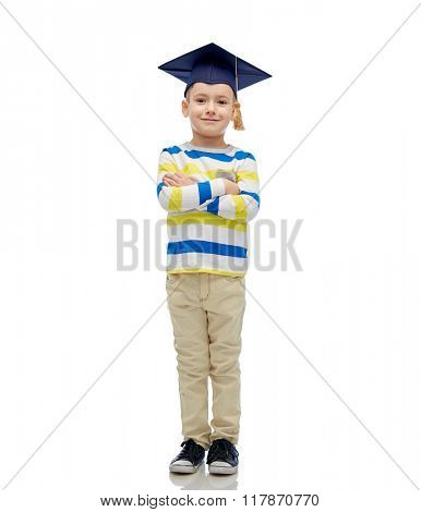 childhood, school, education, learning and people concept - happy boy in bachelor hat or mortarboard