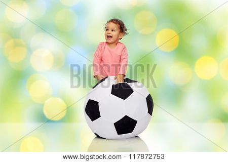 childhood, game, sport, football and people concept - happy african american little baby girl playing with ball