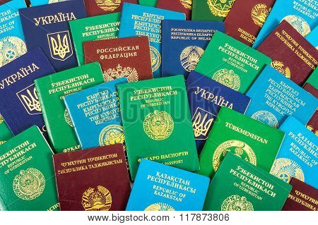 Different Foreign Passports As Colorful Background