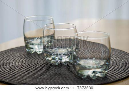 Three empty juice glasses