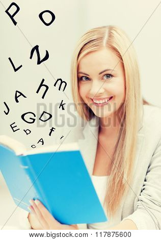 picture of smiling young woman reading book