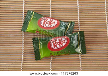 Kuala Lumpur Malaysia  Jun 8th 2015 Kit Kat bar green tea flavor isolated on white. Kit Kat is a chocolate biscuit bar confection that is manufactured by Nestle