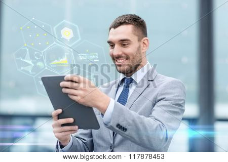 business, education, technology and people concept - smiling businessman working with tablet pc computer and virtual chart projection on city street
