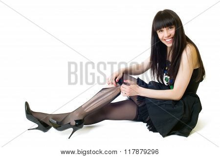 Young smiling woman in torn stockings