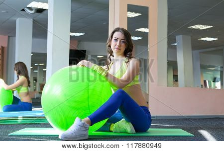 woman doing exercise and stretching on a fitness ball
