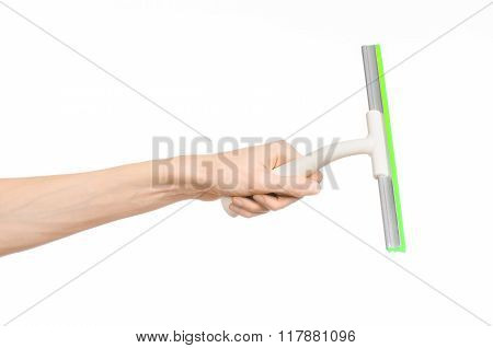 Household Cleaning And Washing Windows Theme: Man's Hand Holding A Green Scraper Windows Isolated On