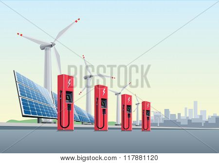 Electric Charging Station In Front Of The Windmills And Solar Panels