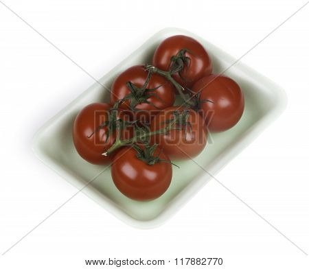 ripe tomatoes in the package isolated on white