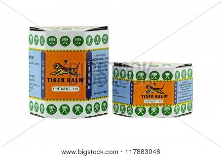 BANGKOK, THAILAND - DECEMBER 2015 : Packages of Tiger Balm isolated on white  in Bangkok, Thailand on December 21, 2015. Tiger Balm is medicinal ointment made from herbs that has pain-relieving remedy