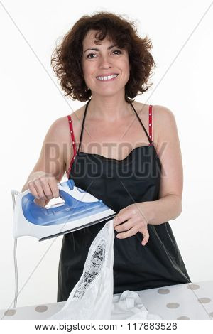 Smiling Woman Is Ironing Clothes On Ironing Board