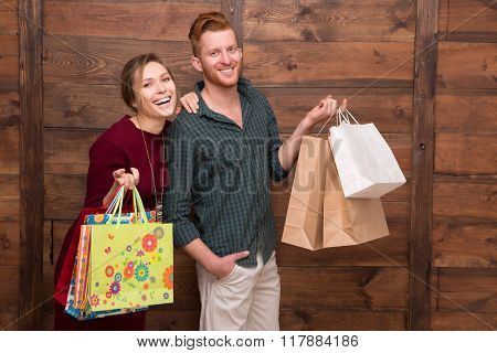 Happy couple with shopping bags